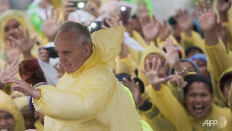 Francis braves the wind and rain at open air Mass in Tacloban, Leyte, Philippine.