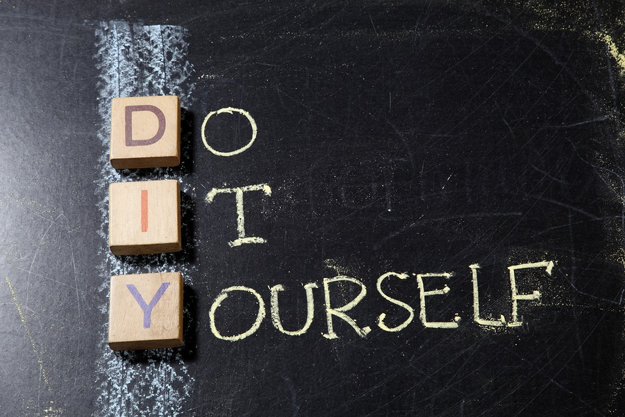 Do It Yourself (DIY), business concept acronym on blackboard