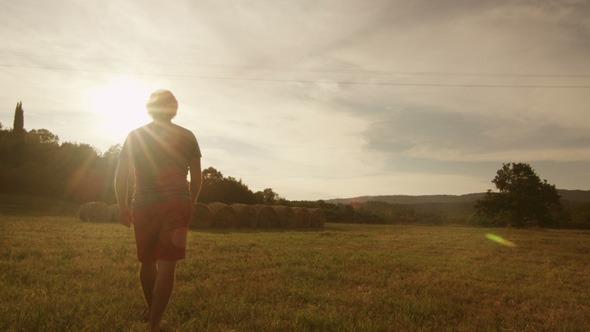 Man_Walking_and_Streching_in_Nature_1_590