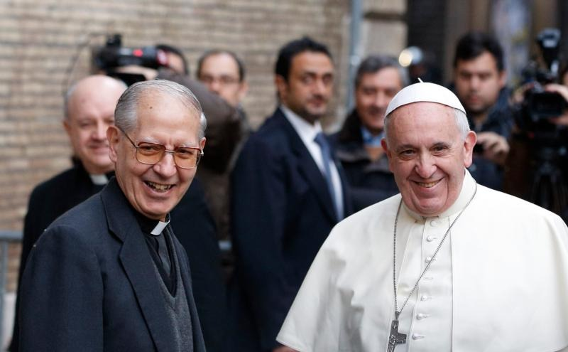Father Adolfo Nicolas, superior general of the Society of Jesus, and Pope Francis, also a Jesuit, are seen together before celebrating Mass at the Church of the Gesu in Rome in this Jan. 3, 2014, file photo. Jesuits from around the world will meet in Rome beginning Oct. 2 to elect a new superior general. Father Nicolas, who turned 80 in April, plans to resign after leading the order since 2008. (CNS photo/Paul Haring) See JESUIT-GENERAL-CONGREGATION Sept. 16, 2016.